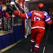 CHELYABINSK, RUSSIA - APRIL 24: Russia's Yegor Zamula #12 is greeted by fans as he heads to the dressing room following warm-up and prior to preliminary round action against Slovakia at the 2018 IIHF Ice Hockey U18 World Championship. (Photo by Andrea Cardin/HHOF-IIHF Images)