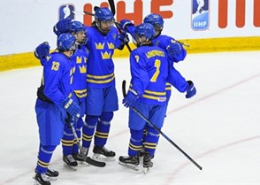 CHELYABINSK, RUSSIA - APRIL 29: Sweden's Marcus Westfalt #26 (centre) celebrates with teammates David Gustafsson #13, Nikola Pasic #22, Nils Lundkvist #7 and Oskar Back #11 after scoring on team Czech Republic during bronze medal game action at the 2018 IIHF Ice Hockey U18 World Championship. (Photo by Andrea Cardin/HHOF-IIHF Images)