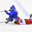 CHELYABINSK, RUSSIA - APRIL 29: Sweden's Oskar Back #11 avoids a diving stick check by Czech Republic's Matej Pekar #10 during bronze medal game action at the 2018 IIHF Ice Hockey U18 World Championship. (Photo by Andrea Cardin/HHOF-IIHF Images)